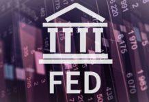Άνοδος στη Wall Street, καθώς οι επενδυτές στρέφουν την προσοχή τους σε ένα μπαράζ μακροοικονομικών ανακοινώσεων από τη Federal Reserve (Fed)